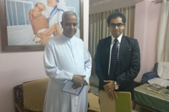 Dr. Edmond Fernandes with the Archbishop of Guwahati, Assam
