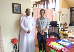 Bishop of Mangalore Rev Dr. Peter Paul with Dr. Edmond Fernandes